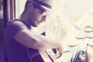 J'ai commencé la guitare à 15 ans